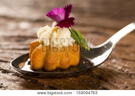 Mini salty churros accompanied by flavored coffee reduction with Kombu and stuffed with cream cheese candied orange in a spoon. Taste gastronomy fingerfood poster