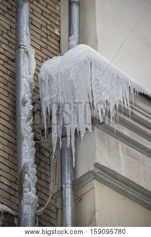 icicles downspout on the roof of building