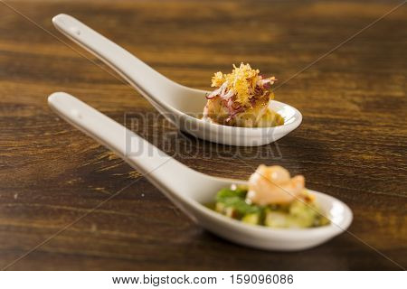Grilled fish with reduction of yellow fruits and aligot baiano in a spoon. Taste gastronomy finger food poster