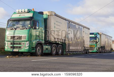 HANNOVER / GERMANY - NOVEMBER 27 2016: Schwandner transport logistic trucks stands on a street. Schwandner is a special and heavy duty transport company from bavaria.