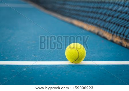Tennis Ball and Racket in tennis cort, Tennis court, Tennis ball,  shadow tennis, Tennis sport, Tennis concept, Tennis ball green color.