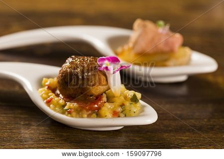 Broiled Pork Brulee, Quirela, Cherry Tomato Confit And Tolenia In A Spoon. Taste Gastronomy Finger F