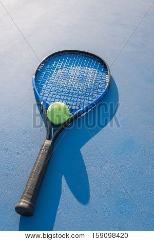 Tennis Ball and Racket in tennis cort, Tennis court, Tennis ball, Tennis racket, shadow tennis, Tennis sport, Tennis concept, Tennis ball green color, Tennis racket blue color