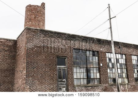 Abandoned School Power Plant With Broken Windows And Crumbling Brick Smokestack Iii