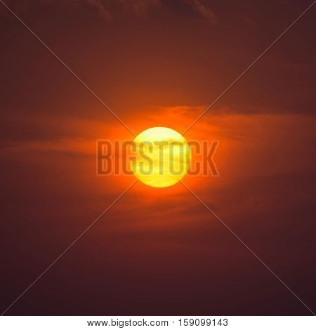 Summer Sunset. The Setting Sun In A Cloudy Sky Background