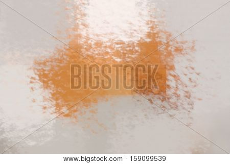 blurred abstract background of colored spots orange and white