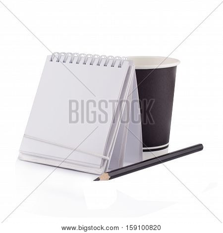 Front view of a white paper notebook with metallic spiral a black pen and a take away coffee black up isolated