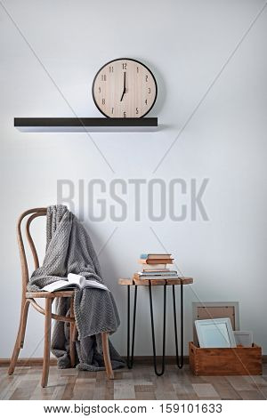 Simple interior with stool and decorations on white wall background