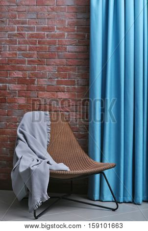 Chair in room with blue curtains