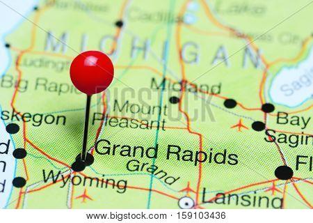 Grand Rapids pinned on a map of Michigan, USA