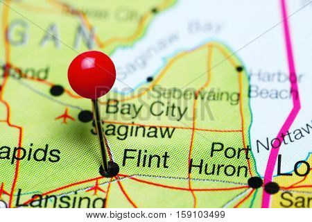 Flint pinned on a map of Michigan, USA