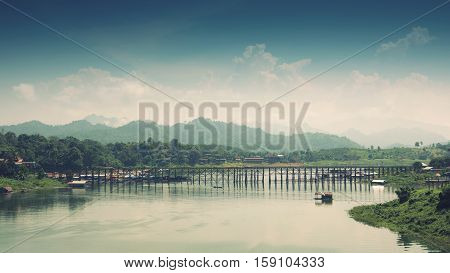 Mon bridge officially name is Auttamanusorn-Wooden-Bridge. A wooden bridge across the Songgaria river to the village of Mon. It is the longest wooden bridge in Thailand.