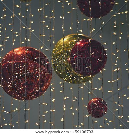 Colorful christmas Decoration. Winter holidays and traditional ornaments on a Christmas tree. Lighting chains - candles for seasonal background.