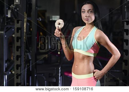 Fit Woman In Gym Holding Donut, Doughnut