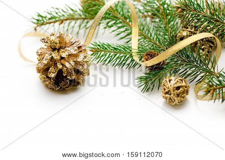 Merry Christmas background. New year. Tree, gold, cones, ornaments