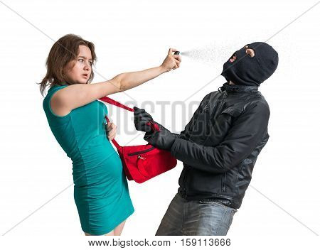 Self Defense Concept. Young Woman Is Fighting With Thief And Usi