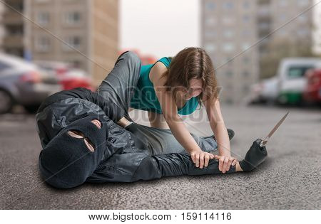 Young Woman Is Fighting With Thief On Street. Self Defense Conce