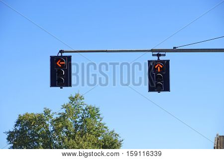 traffic light with red light on blue sky background .