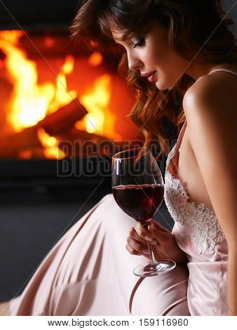 Sexy woman in front of the fireplace