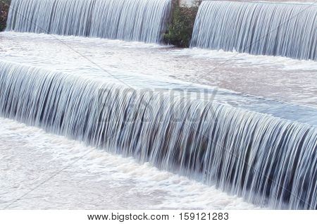 Double Waterfall Of A Lake. Artificial Water Falling From A Lake