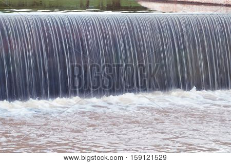 Waterfall Of A Lake. Artificial Water Falling From A Lake