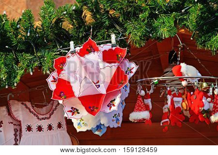 CLUJ-NAPOCA ROMANIA - DECEMBER 5 2015: Colorful napkins and trinkets hanged at Christmas market stand