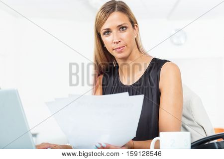 Working Woman With Lots Of Documents