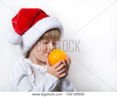 young maiden in a cap and with a orange