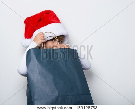 young maiden in a red cap looking for the gifts in the package