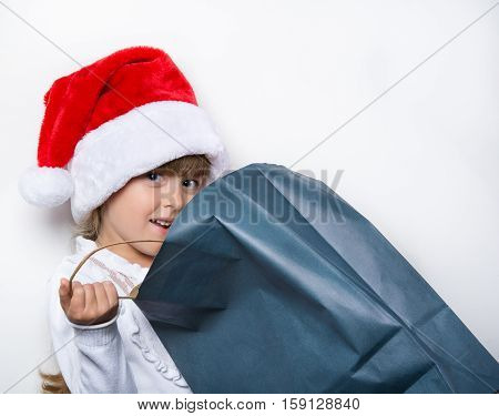 young maiden in a cap looking for the gifts in the package
