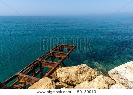 Clear waters and rocks on Embankment in Skala Maries, Thassos island, East Macedonia and Thrace, Greece