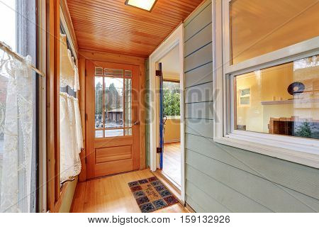 Entrance Porch Interior With Wood Paneling