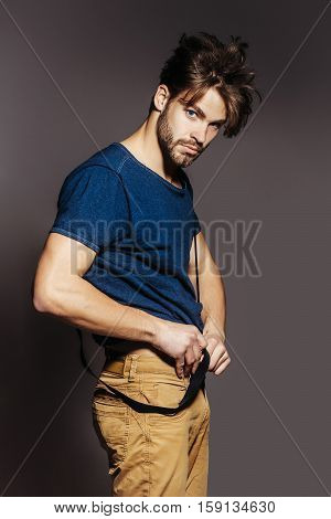 Handsome Man Puts On Trousers