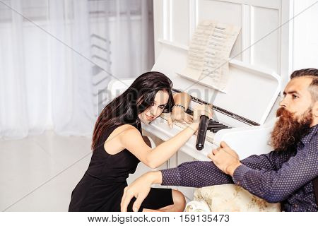 Couple With Piano And Microphone