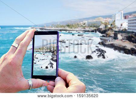Taking A Photo Of The Coast