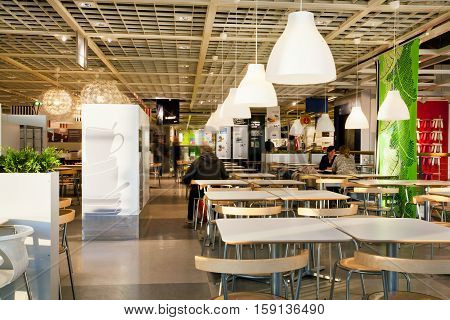 KATOWICE, POLAND - AUG 4, 2014: People have dinner in eatery space of the giant international IKEA store on August 4, 2014. Katowice lies within an urban zone with a population of 2746460