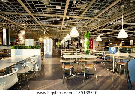 KATOWICE, POLAND - AUG 4, 2014: Bright light inside the huge cafe of the popular family shopping mall IKEA on August 4, 2014. Katowice lies within an urban zone with a population of 2746460