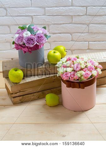 Flowers And Apple On Wooden Planks