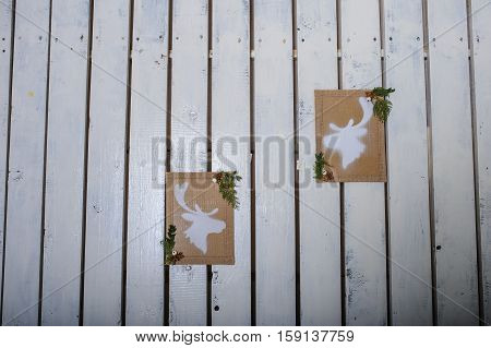 Christmas motive in scandinavian style in front of white wooden wal