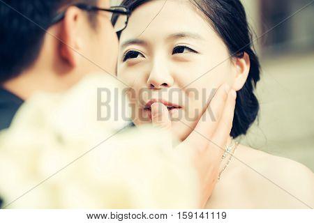 Pretty Bride Looks At Groom