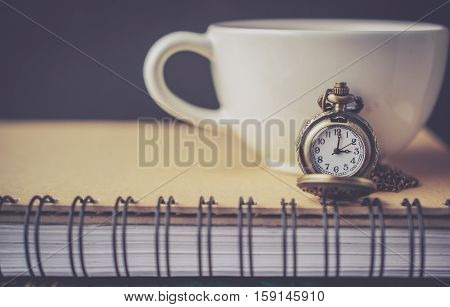 Pocket Watch on the Book and Coffee Cup with Blank Space in Vintage Tone
