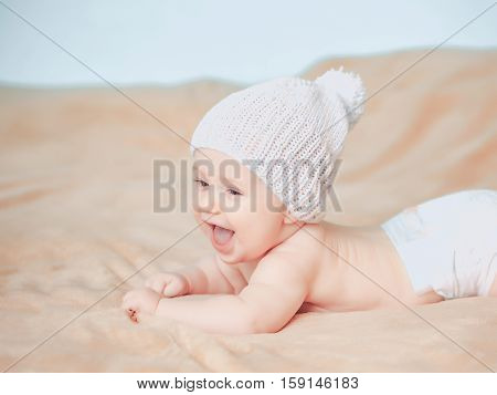 Little Baby Boy In White Knitted Hat