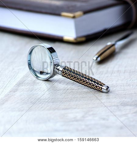 Stationery Magnifier On A Grey Background