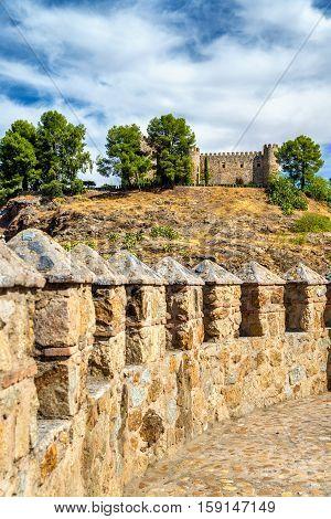 Castillo de San Servando as seen from Alcantara Bridge in Toledo - Spain