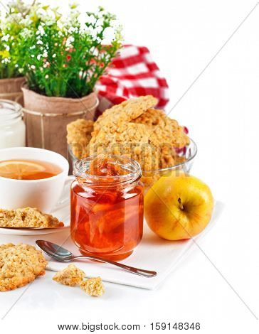 Breakfast with tea jam and fresh cookies. Isolated on white background