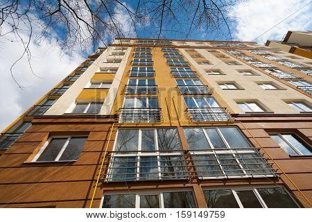 The new multi-storey building. Spring, blue sky reflected in windows. Kiev, Ukraine.