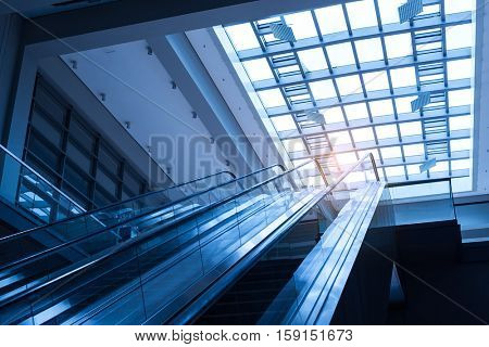 ascending escalator in a public transport area