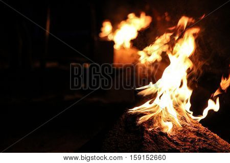 burning bonfire with bright flame in darkness