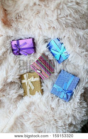 Colored Gift Boxes Scattered On The Soft Bright Plaid Fur