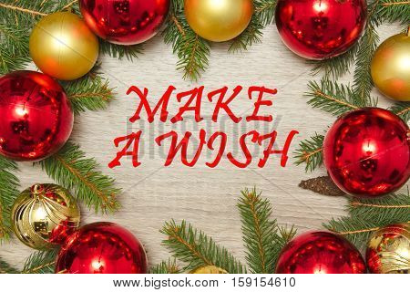 Christmas decoration with text MAKE  A WISH on wooden background
